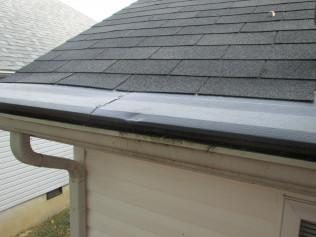 ROOFER DAMAGE TO GUTTER HELMET: LADDER DENTS PLUS OUT OF ALIGNMENT